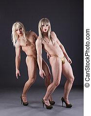 Two transvestites in heels - Full length portrait of two...