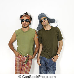 Portrait of two trendy young men standing with attitude - isolated