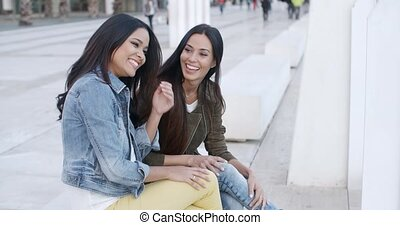 Two trendy young women relaxing