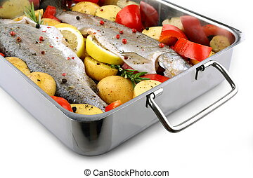 Two trout with potatoes and peppers on baking sheet