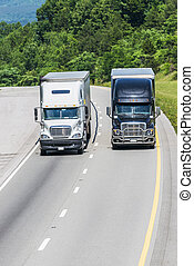 Two Trucks on The Highway