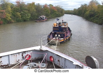 Two tugboats in canal