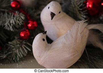 Two Turtledoves - Two white birds in a Christmas wreath...
