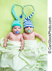 two twins brothers babies weared in hats