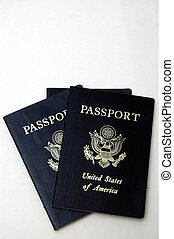 Two US Passports - Two American passports isolated against a...