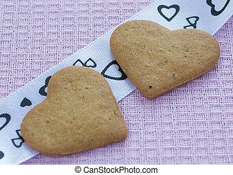 Two Valentine's cookies