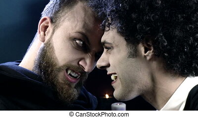 Two vampires fighting closeup - Angry handsome male vampires...