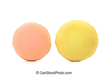 Two various macarons isolated on a white background .