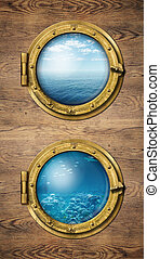 Two vertical ship windows with ocean surface and underwater
