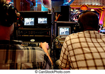 two video operators controlling camera at performance show...