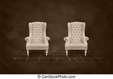two vintage chair in a dark room