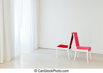 two vintage chairs in an empty white room