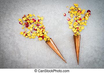 Two vintage copper cones with rose petals