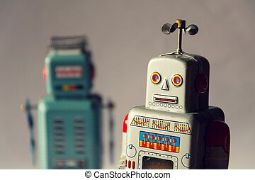 Two vintage tin toy robots, robotic delivery, artificial intelligence concept