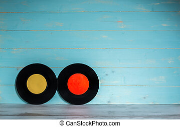 Two vinyl records on wooden background