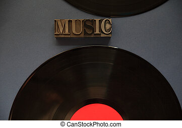 Two vinyl records with music word
