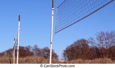 Two volleyball nets on the ground
