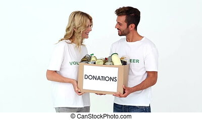 Two volunteers holding a donations