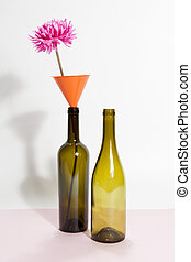 two wacky glass bottles on a bicolor background - Two brown...