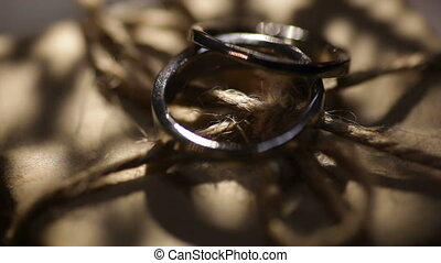Two wedding gold rings and stars silhouettes.