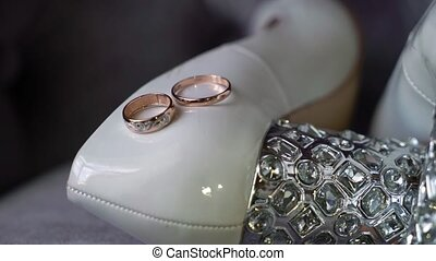 Two wedding rings and bridal shoes - Two wedding rings and...