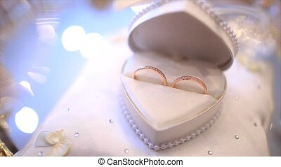 Two wedding rings made of white gold in a box.