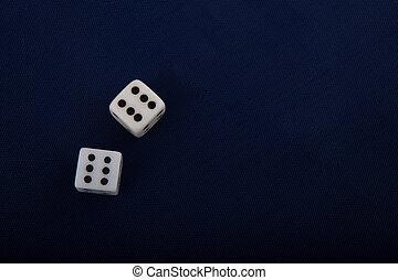 Two white dice cubes on blue background.