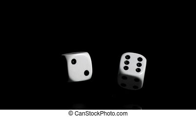Two white dices in super slow motion rebonding against a...
