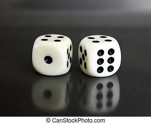 two white dices over black background