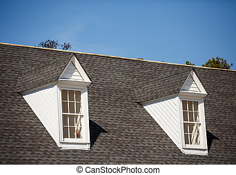 Two White Dormers on Grey Shingle Roof - Two white wood...
