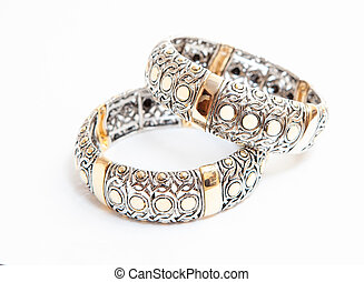 Two white gold braceletes on white background