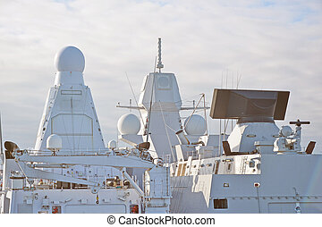 Two white naval ships with radar and other communications.