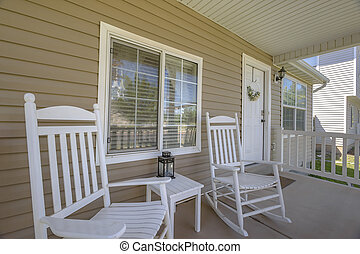 Two white rocking chairs in home entry