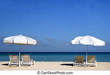 Two White Umbrellas - Two white umbrellas with sun loungers...