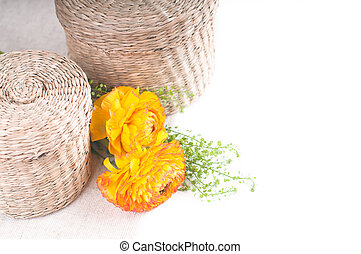 wicker baskets and yellow-orange flowers