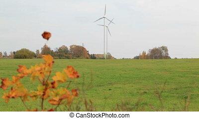 Two wind turbines in the field.