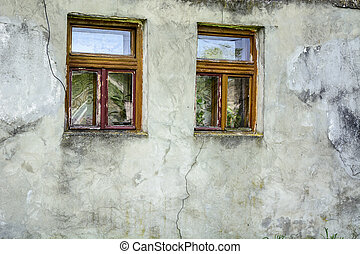 Two windows old clay wall