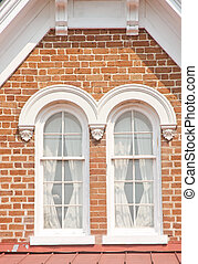 Two Windows on Brick Dormer