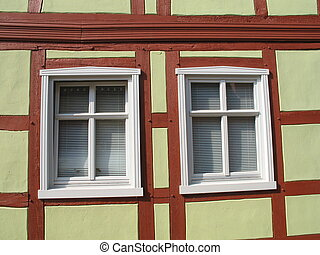 Two windows - Photo of two windows of a half-timbered house.