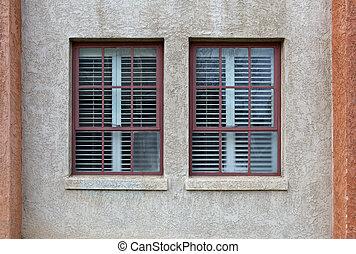 Two windows stucco wall