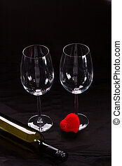 Two wine glasses and red heart.