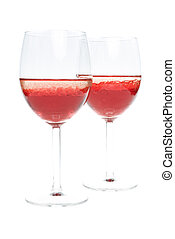 two wineglass with colored red liquid and with bubbles of oil on a white background
