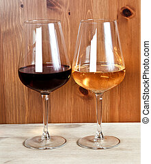 two wineglasses with red wine and white wine