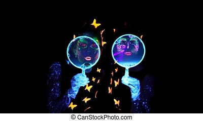 Two woman blowing bubbles in camera