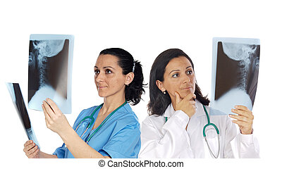 Two woman doctor with radiography a over white background