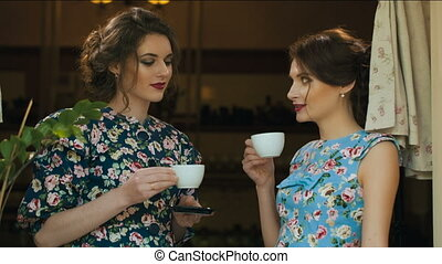 Two woman drinking tea and talking
