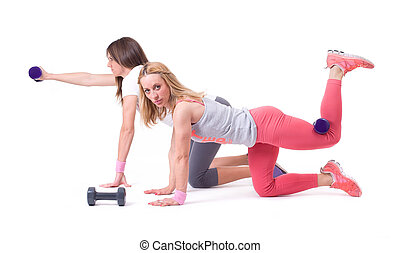 Two woman exercise with dumbbells