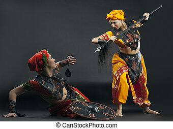 Two woman fight with spear and shield - arabia theme