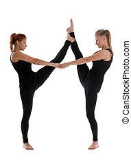 two woman gymnast in black stand on split