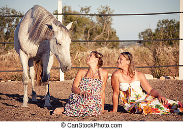 two woman horse and dog outdoor in summer happy